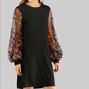 Black dress with floral sleeves